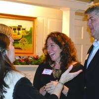 Debbie greets Kecia and Joe Burns