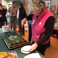 Sue Andrews cuts the cake