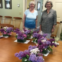 Sue and Laurie arranging flowers for the Sargent Room