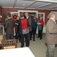 Guests visit in the Sargent Room.