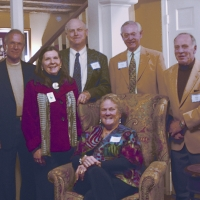 Former Chairs, Heidi Lauridsen, John Garvey, Woody Blunt, Chris Cundey, and Dan Wolf with Debbie Stanley at the 25th Anniversary Holiday Party in 2012.