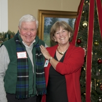 Peggy Hutter enjoys chatting with Steve Ensign at the annual Holiday Party at the New London Inn