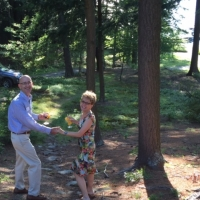 Patsy and Greg Steverson take a walk to the lake at the annual Progressive Dinner, this at the Pattison home.