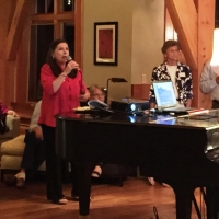 Debbie Stanley addressing the guests at a Progressive Dinner (or taking musical requests from her audience)