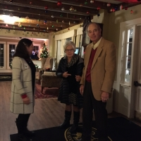 Debbie thanks Jeanine and Bill Berger for attending the Holiday Party.