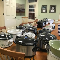 Ausbon Sargent always provided a chili dinner at the end of the ride.  Here, the many crockpots illustrate the quantity needed to satisfy the many riders.
