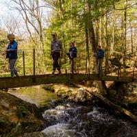 Hikers crossing the I-beam bridge
