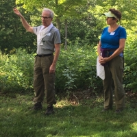 John Garvey and Cotton Cleveland share information about their Wayne's Woods protected property in Goshen.