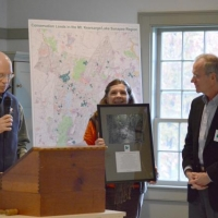 Doug Lyon and Debbie Stanley thank John Garvey at the Annual Meeting for his past service to Ausbon Sargent