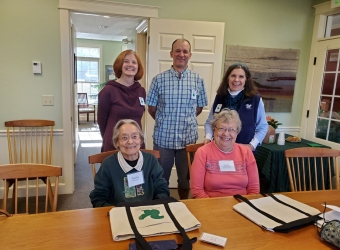 (Seated L-R) Sandra Blackington and Cora Collins Kangas; (Standing L-R) Board Chair Frances Harris, Land Protection Specialist Andy Deegan, and ExecDir Debbie Stanley at the property closing.